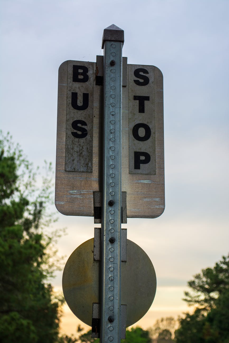 black and white bus stop sign